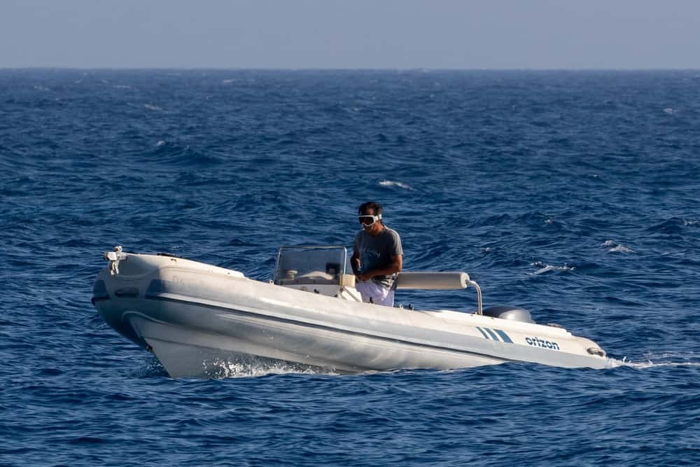 a man drives a RIB boat