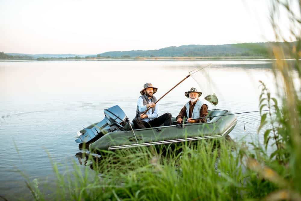 Grandfather with son fishing on the Intex Seahawk 4 inflatable boat