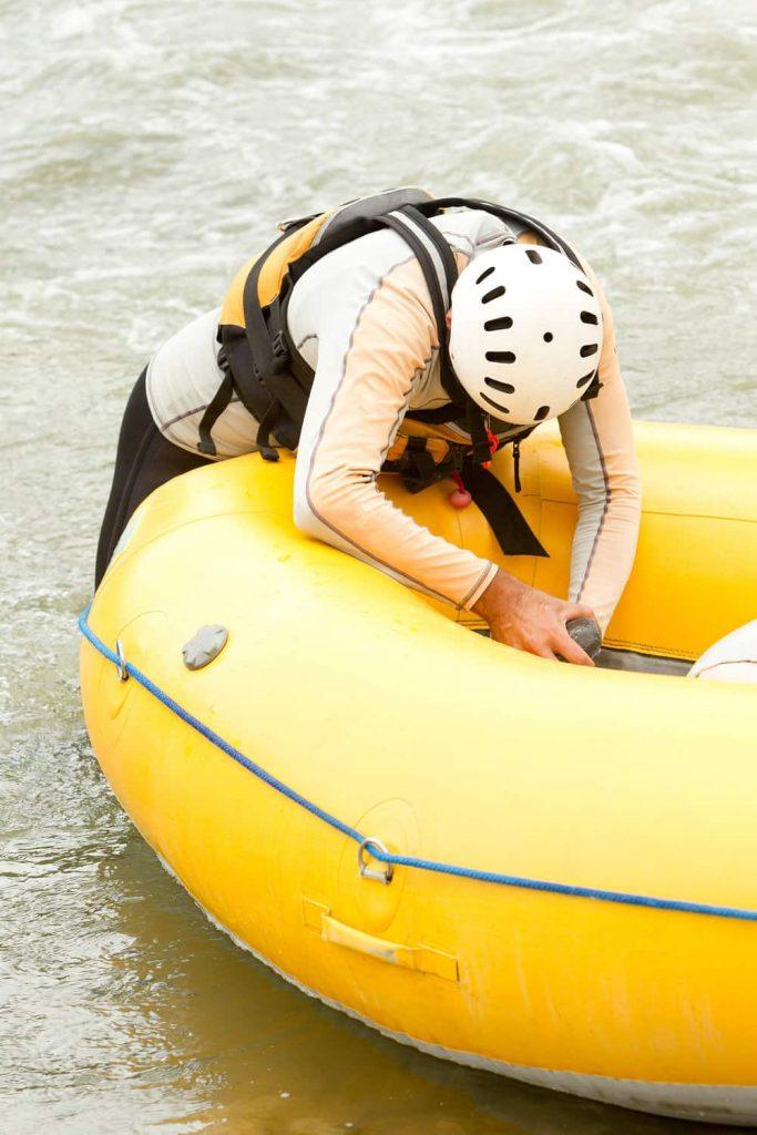 a man repairing his inflatable boat
