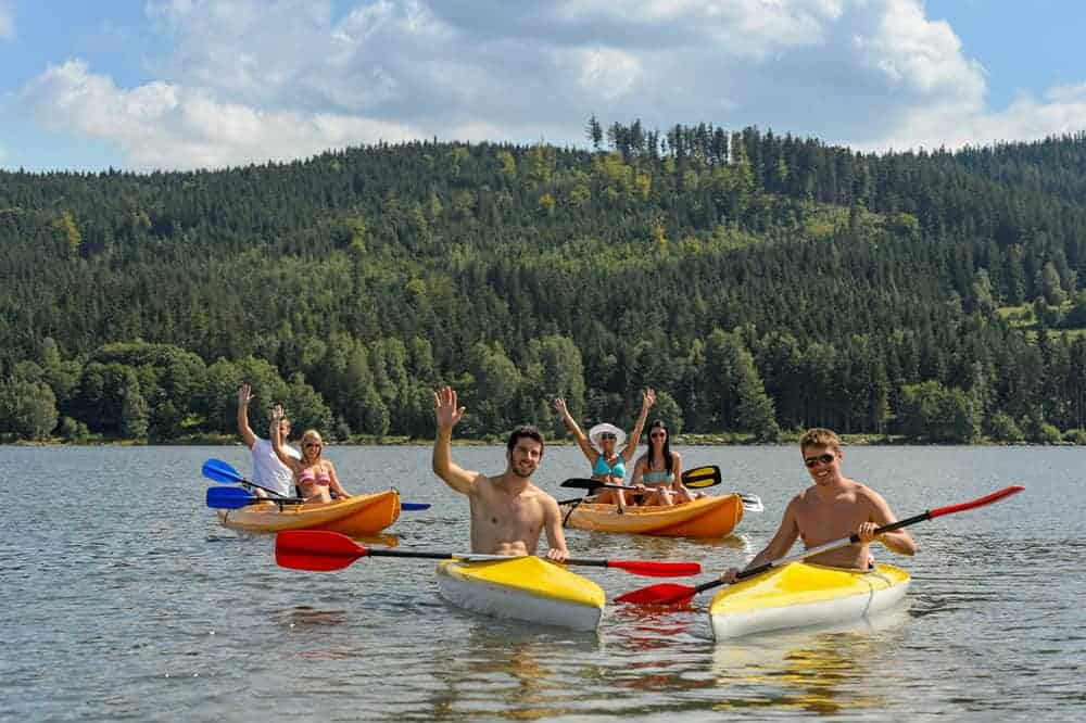 friends enjoy kayaking on inflatable and hard shell kayaks