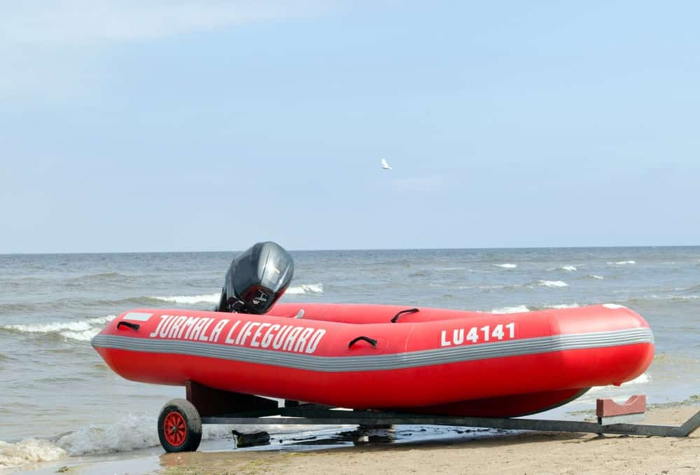 inflatable boat trailer on sea shore