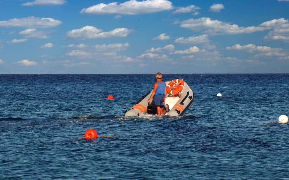 an overloading inflatable boat sinking