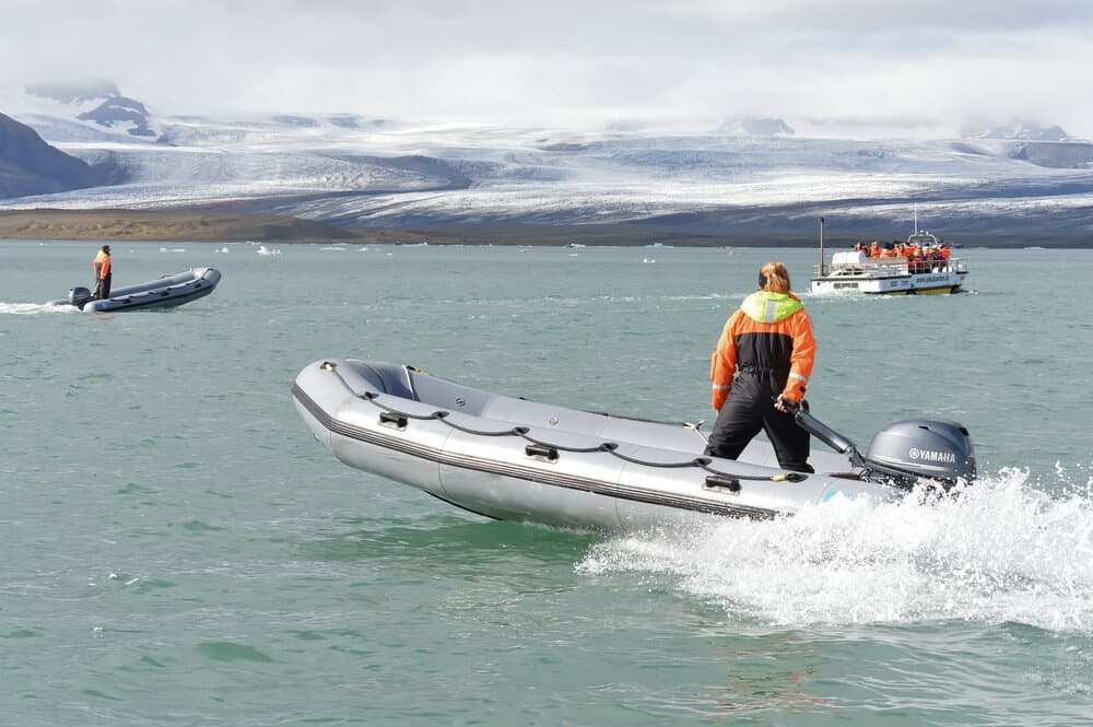 a woman standing on Solstice inflatable boat
