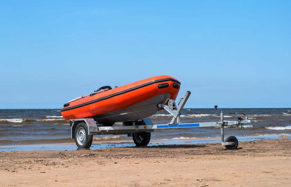 inflatable boat on a trailer on the beach