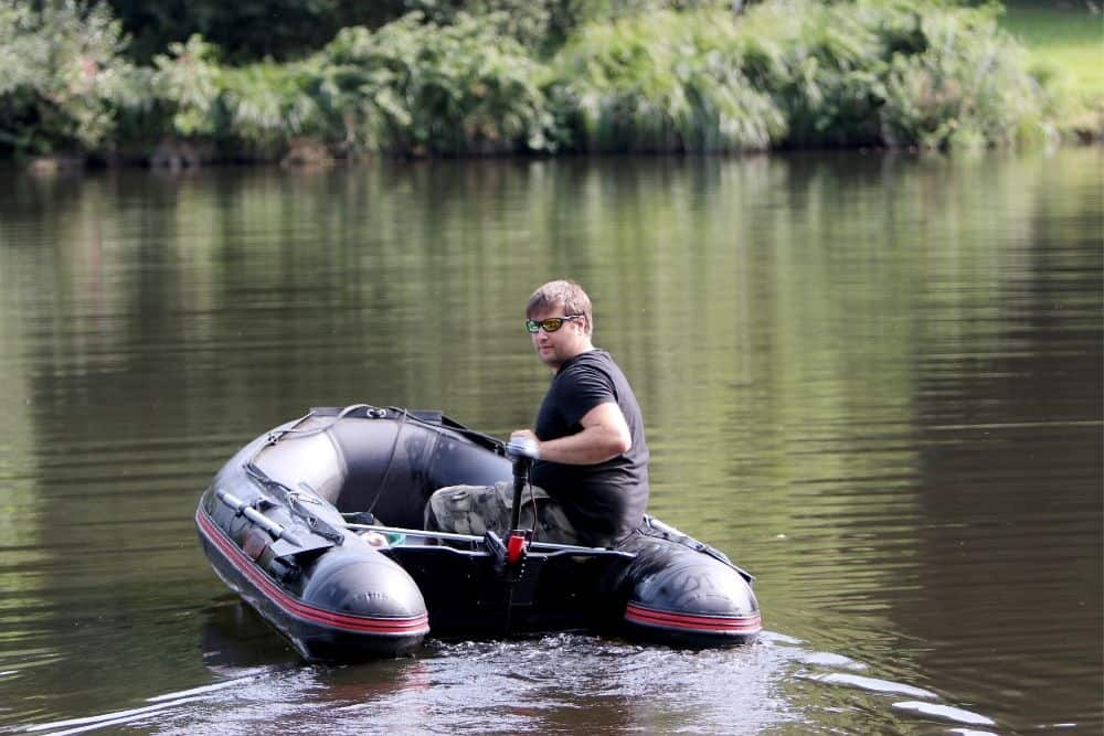 An Inflatable Boat going upstream with a trolling motor