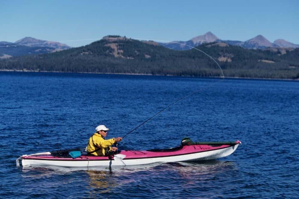 man fishing on a pink kayak with mounted trolling motor