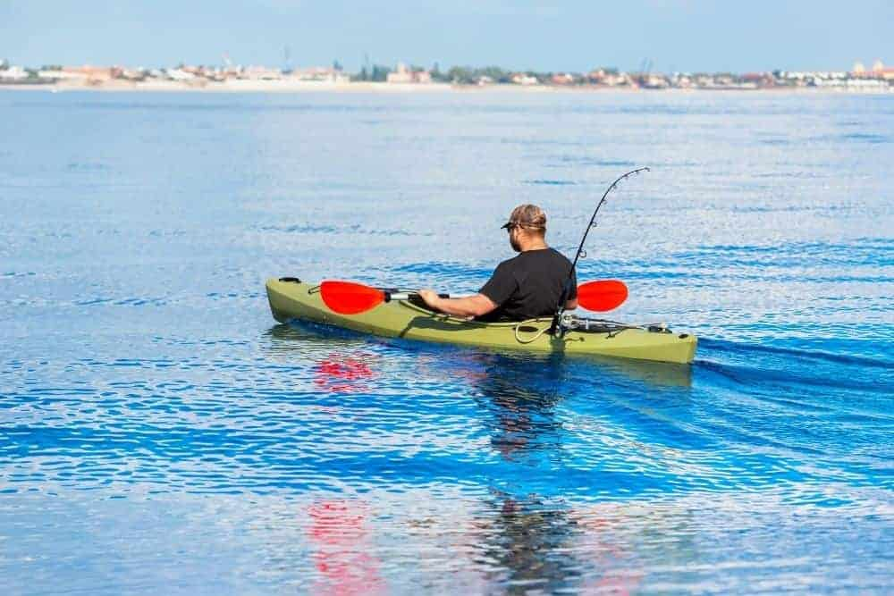 man on a kayak fishing on saltwater