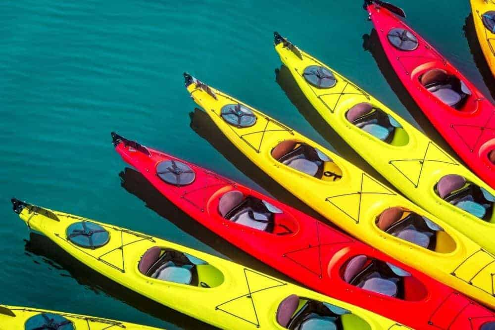 red and yellow kayaks on the ocean