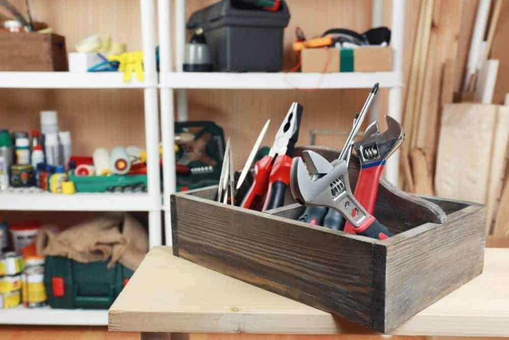 tools in wooden tool box