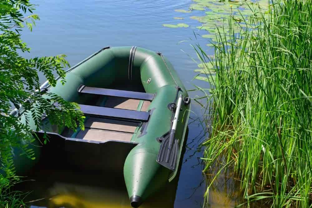 an inflatable boat with broken transom on a lake