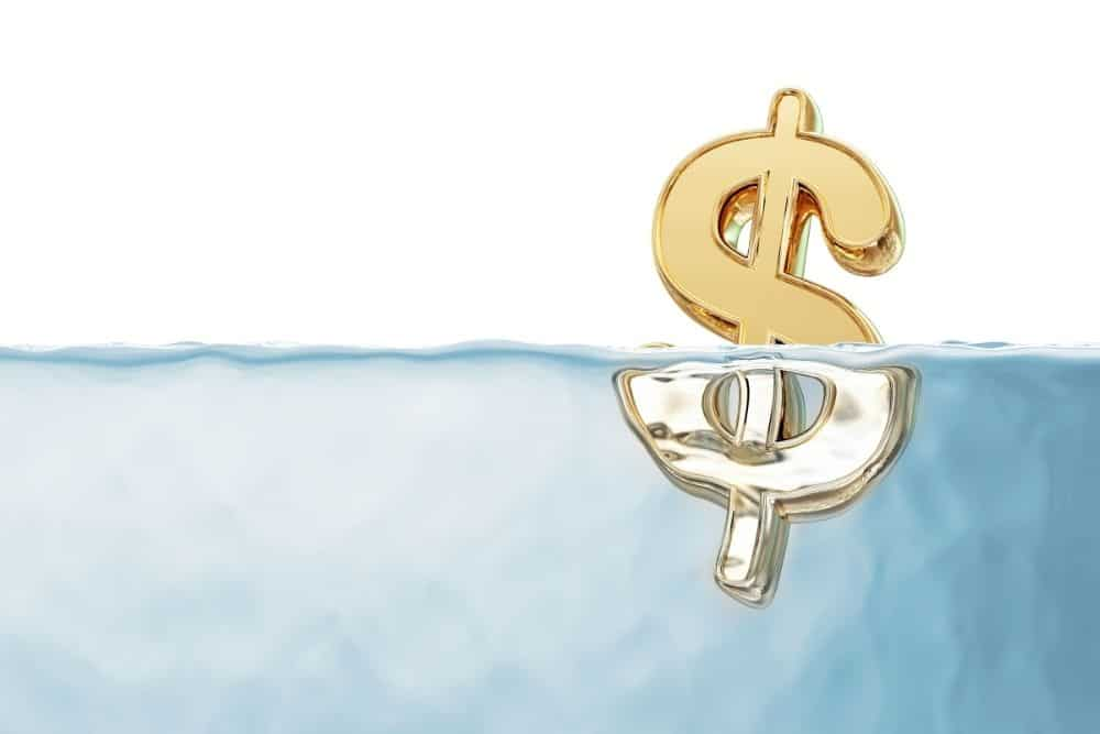 golden dollar sign in water