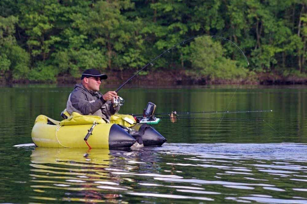 a man in float tube fishing on a river