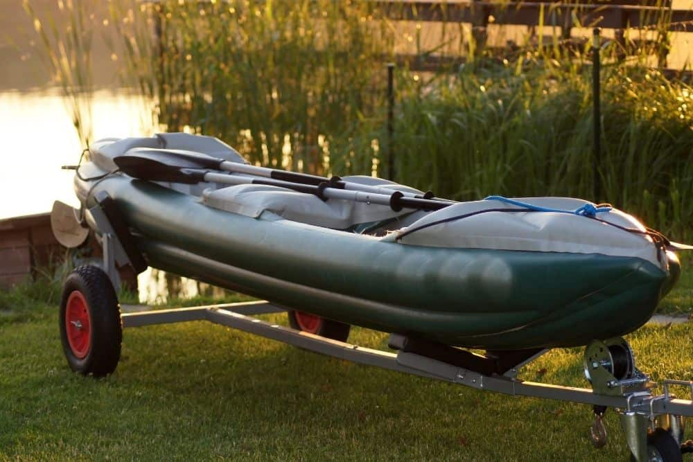 an inflatable canoe with its trailer