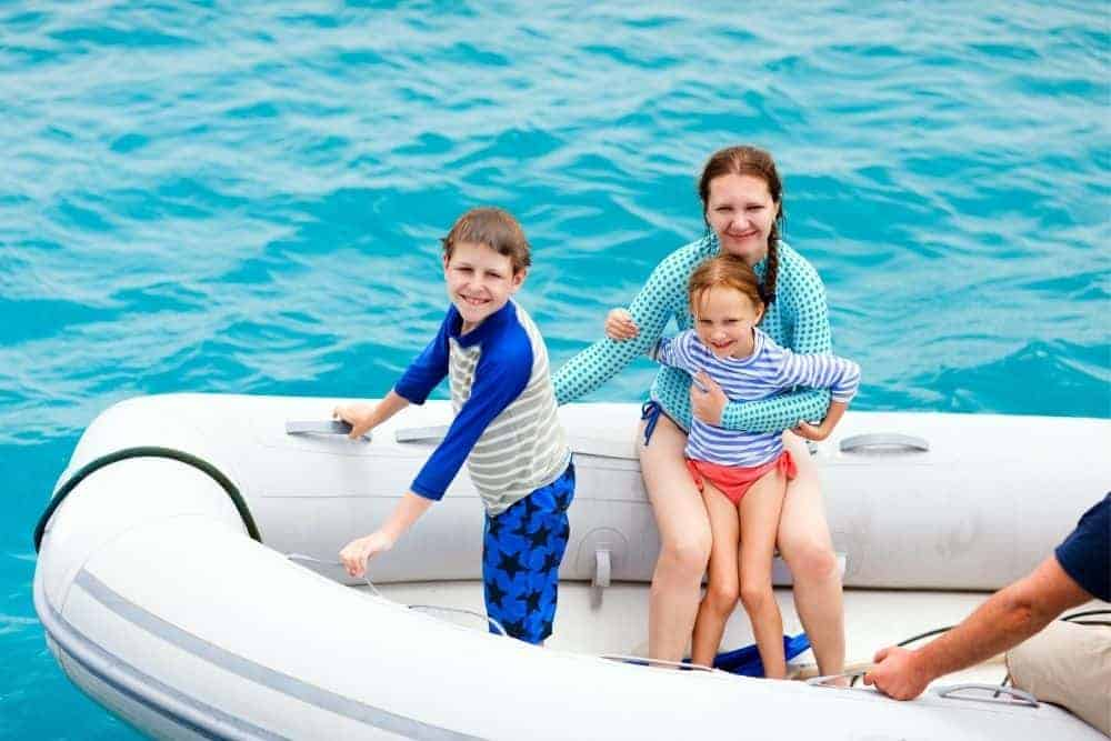 family in a dinghy inflatable boat
