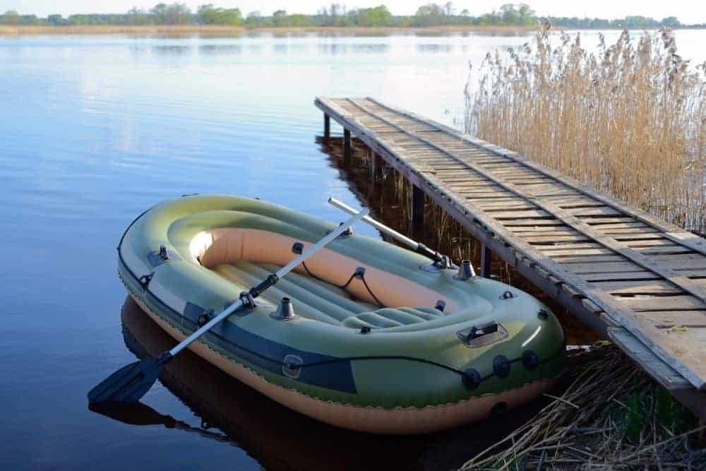 a soft green inflatable boat at the boat ramp