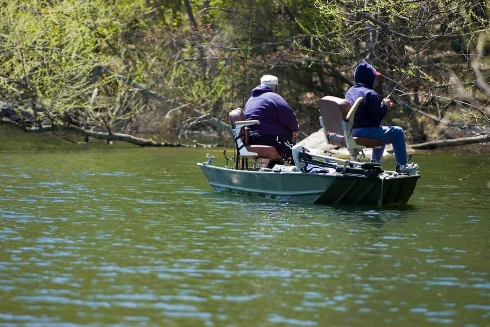 anglers using a trolling motor on a boat