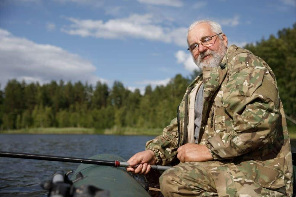 old man fishing on an inflatable boat