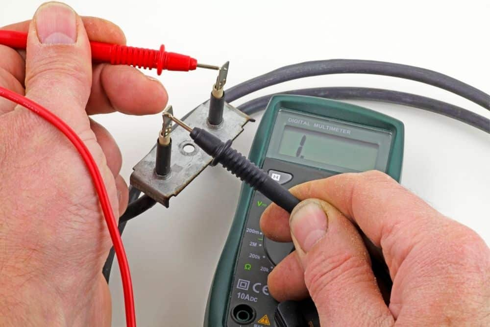 Testing test amperage of battery wires